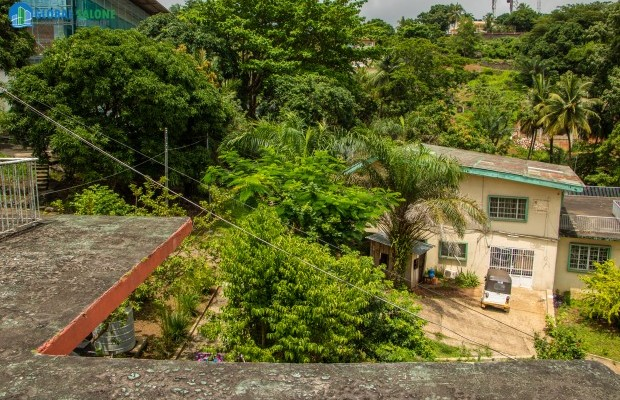 Photo #1 Land with Structure for sale in Sierra Leone, Spur Road